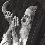 Man blowing a shofar.
