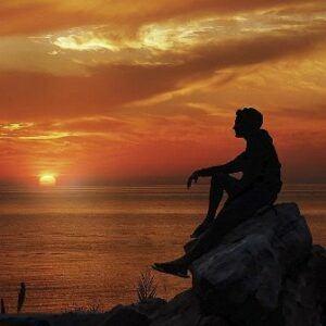 Man Praying at Sunrise