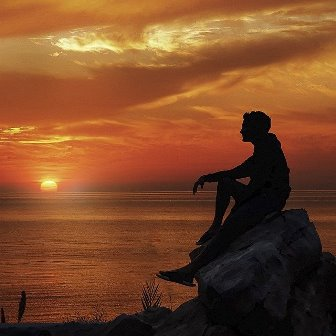 Man Praying at Sunrise