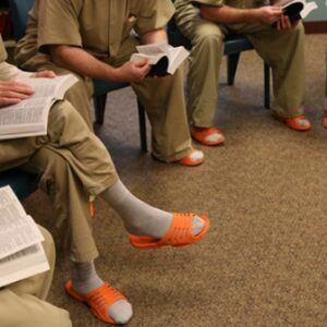 Prison inmates having a Bible study.